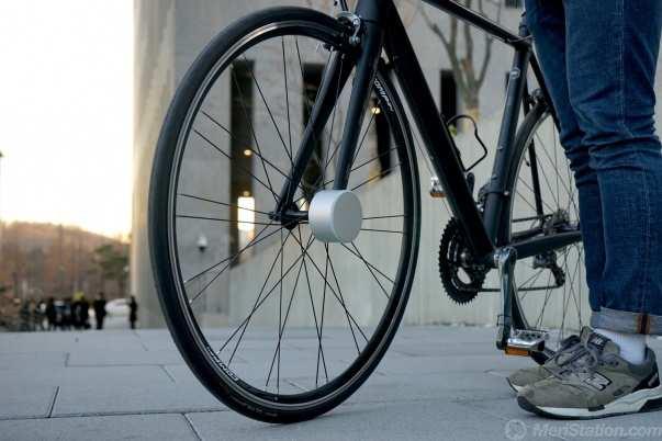 Candado abierto con la bicicleta lista para circular